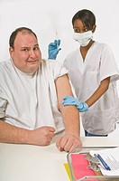 Nurse giving overweight man a needle