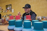 Rapid City, South Dakota - Del Loefer, a member of the Rosebud Sioux, creates pottery at Sioux Pottery