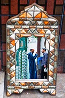 Morocco, Tangier Tetouan Region, Tangier, reflections in a mirror at the Petit Socco the small souk