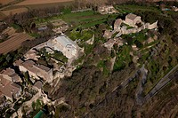 France, Vaucluse, Parc Naturel Regional du Luberon Natural Regional Park of Luberon, Menerbes, perched village on a rocky outcrop aerial view