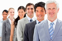 Close_up of smiling business people in a single line with focus on the first person