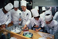 Students at work in a dessert designing class at a culinary school.