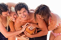 Four people playing sports and laughing