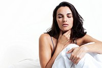 Woman in bed, having a sore throat