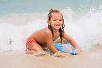 Young Brazilian girl playing in the surf. Copacabana Beach, Rio de Janeiro, Brazil.