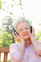 Woman with her eyes closed while listening to music