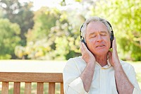 Man thoughtfully listennig to music