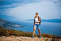 Woman hiking at the seaside, Omis, Adriatic coast, Croatia, Europe
