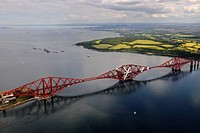 United Kingdom, Scotland, Firth of Forth, the Forth Railway Bridge and Edinburgh in the background aerial view