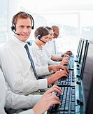 Call center agent sitting among his colleagues