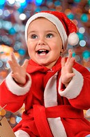 Happy clapping Christmas toddler girl. Clipping path is included.