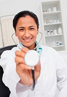 Smiling doctor wearing her stethoscope