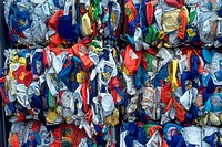 Bales of crushed plastic bottles at a recycling center.