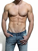 Man with a naked torso wearing a pair of jeans