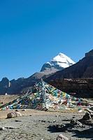 Tibetan Buddhism, colorful prayer flags, Tarboche flagpole, snow-covered holy Mount Kailash, Gang Rinpoche mountain, pilgrims' path, Kora pilgrimage, ...
