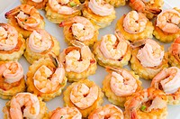 a lot of shrimp snacks on buffet table, catering