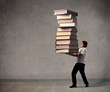 Man carrying a big stack of books