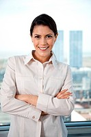 Portrait of pretty businesswoman with arms crossed