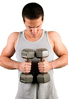 Young man excercising with dumbells