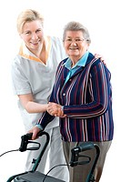 Senior woman with her doctor or caregiver