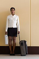 Portrait of businesswoman with luggage