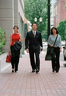 Business team walking down urban street