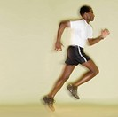 Side view of man running