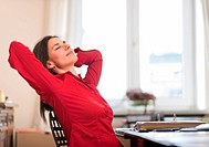 Businesswoman stretching at desk