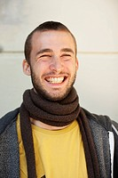 Smiling man wearing scarf indoors