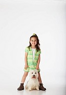 Girl standing next to dog