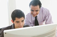 Two businessmen looking at computer screen