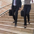 Blurred view of business people´s legs descending stairs