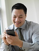 Young businessman using a electronic organizer