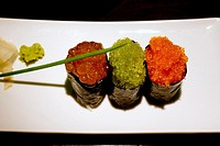 Three makis of caviar and seaweed.