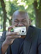 African man using digital camera