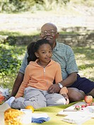 African grandfather and granddaughter at picnic