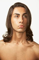 Studio shot of Middle Eastern man with bare chest