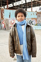 African boy wearing winter clothes in urban scene