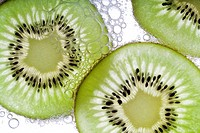Slice kiwi fruit and bubbles