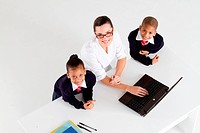overhead view of elementary teacher and student in front of a laptop