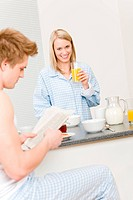 Breakfast happy couple eat cereal drink juice in kitchen