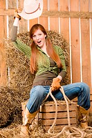 Crazy young cowgirl horse_riding country style in barn
