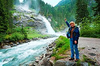 Alps beautiful mountain waterfall Krimml Austria, Tirol summer view and woman_tourist near