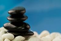 Pebbles on white stones on blue sky background