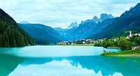 Tranquil summer Italian dolomites mountain lake and village view Auronzo di Cadore. Four shots composite image.