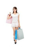 asian woman holding shopping bag
