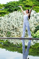 Woman in white Performing yoga in natural setting