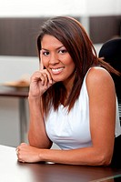 Beautiful business woman sitting at her desk in the office