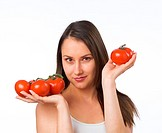 Young woman holding fresh tomatoes