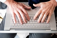 Close_up of Man´s Hands On Computer Keyboard